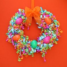 Greet your Easter guests with a brightly colored wreath that is sure to bring a smile to their faces! #hoptoit