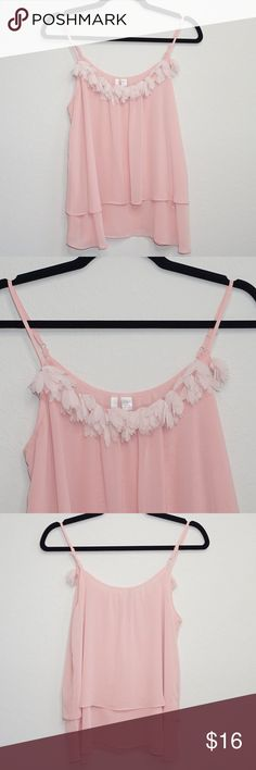 """LC Lauren Conrad Flower Camisole LC Lauren Conrad Camisole Size Small Condition: Pre-owned; Excellent- No stains or rips Material: 100% Polyester Measurements (approx. when flat):Length 26"""" Chest 18"""" Features: - Beautiful top - Lined - Adjustable straps - Flowy  Please check out my other designer items! LC Lauren Conrad Tops Camisoles"""