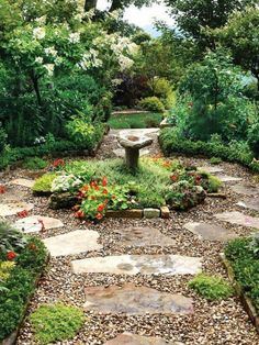 Hard landscaping ideas for a cottage garden pottager front garden - Large flagstone pavers, surrounded by pea gravel, create a rustic, winding path in this lush backyard that's filled with blooming perennials and ornamental trees. Paver Path, Flagstone Pavers, Stone Walkway, Rock Pathway, Stone Paths, Pebble Walkway Pathways, Rustic Pathways, Large Pavers, Flagstone Pathway