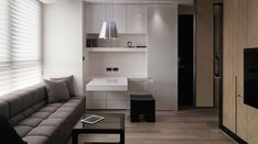 This Tai apartment design, by WCH Interior, is extremely chic and uncluttered despite its small scale; using a cohesive color palette throughout, and unobtrusive storage designs, the dwelling manages to maintain a light and airy appearance