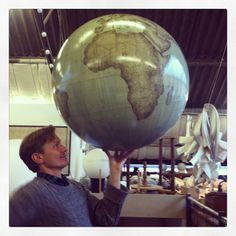 www.bellerbyandco.com  globes, globe, globemaker, peter bellerby, world in hands, world, the world, earth, bellerby and co, handmade, bespoke, custom, artisan, craftsman. Photo : Jade Fenster