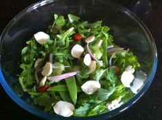 Fresh salad of Rocket Leaf with baby cherry tomatoes, red onion, snow peas, cucumber and baby bocconcini cheese!