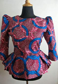Elegant and Stunning on This Ankara Peplum Tops. For you to look elegant this weekend, I've se African Blouses, African Tops, African Dresses For Women, African Print Dresses, African Attire, African Wear, African Fashion Dresses, African Women, African Prints