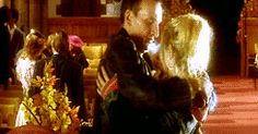 Nine and Rose GIF:  She pulls back from his hug, and for a moment he thinks to protest, keeping his arm around her back and his hand on her shoulder, but for some reason she starts digging around in his jacket pocket- HIS jacket, the one that NOBODY touches- and for some reason it's all he can do is stare tenderly and let her.