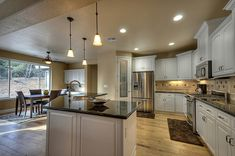 Open, spacious kitchen in a Custom Country 2595 design in a GJ Gardner Homes custom home.