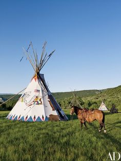 The decoration on the Chief's Tepee exterior is based on Indian ledger drawings | archdigest.com