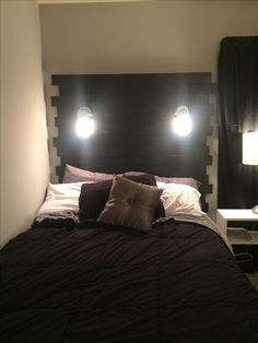 This is a wood headboard I made.  It has 2 sconces that I had to rewire myself (from a hard wire instillation)  I made this for under $60.00!!!