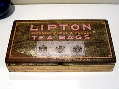 Vintage Lipton Orange Pekoe & Pekoe Tea Bags Metal Tin (Circa 1950)  Tea Time! Bring back the high noon tea time conversations with this vintage metal tin produced by Lipton. Sir Thomas J. Lipton had couple of packer locations in the United States back in the 50's. One location was in San Francisco, and people just can't get enough tea during the time. To keep the tea fresh, metal tins were used as it keeps moisture out, and contain the freshness of the leafs. Vintage Tins, Vintage Metal, Lipton Tea Bags, High Noon, Metal Containers, Metal Tins, Tea Time, Tea Party, San Francisco