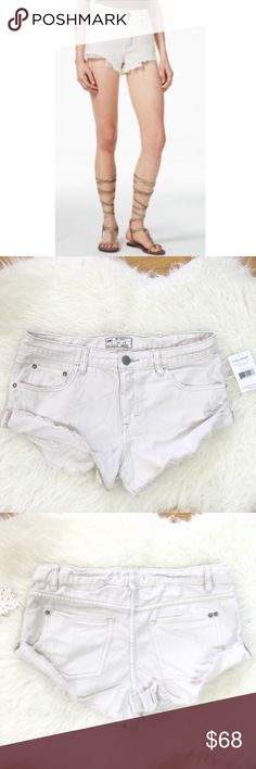 "Free People Polar White Frazed Short NWT Super cute slightly distressed, frazed shorts. Zipper & button fly closure. 100% cotton. Size 27. About 16.5"" across waist (laying flat). Please no trading. I give bundle discount. Free People Shorts"