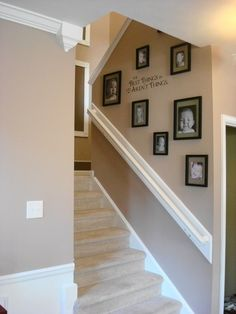 The key to displaying family photos is in the uniformity of mat color and frames. Use different picture sizes to add interest to the grouping, but keep the width of the frames uniform. This way, no matter what you hang, in what configuration, it will look awesome!