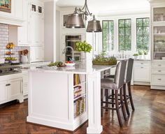 After adding on in back, these homeowners were able to build their fantasy kitchen, complete with marble countertops, custom cabinets, and a pro-style cooktop with a raised griddle. Kitchen Redo, New Kitchen, Kitchen Storage, Kitchen Remodel, The Tile Shop, Bedroom Photos, Best Kitchen Designs, Marble Countertops, Custom Cabinetry