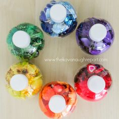Mini Rainbow Sensory Bottles for babies. This is a Montessori friendly way to introduce colors and small objects to infants in a safe and fun way.