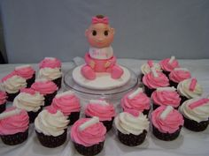 fondant baby and cupcakes for shower
