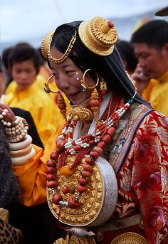 Teenage girl at the Litang Horse festival, Tibet, in traditional Tibetan ceremonial costume from this region. The jewelry in her costume is probably worth over a hundred thousand dollars/euros, and is the main store of wealth for her family. These ornaments will be handed down from generation to generation.  If the Litang Horse Festival hadn't been banned for political reasons in 2008, then people who travel there might have been able to meet her. Seems she was at the festival most years.