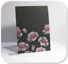 White ink stamped flowers on black card.. one layer