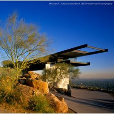 The simplicity of design, combined with the dramatic siting of the Yoder House by Architect Michael P. Johnson created an internationally acclaimed structure. Known for its modern lines and historic principles, it's considered a fresh and original vision from a masterful architect. Timmerman Photography