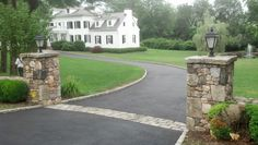 Asphalt driveway with Belgium block apron between pillars