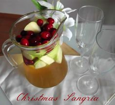 Find out how to make your own festive winter drink, using sparkling wine, apple juice, vanilla vodka, cranberries and apples
