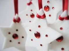 white felt stars to be used as ornaments.