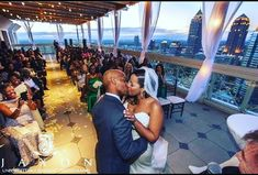 There's so many things to love about this photo taken by @jaxonphoto. First, the couple is stunning and this first kiss as husband-and-wife is captured beautifully. Next, the guests are so happy for the bride and groom that they can't contain their joy; it shows on everyone's faces. ❤️ These are the moments that couples and guests remember for a lifetime. Lastly, how could we not gaze at the colors of the sky and the cityscape view from the rooftop of @thepeachtreeclub? This is the best… First Kiss, Rooftop, Groom, Husband, Faces, Joy, In This Moment, Bride, Couples