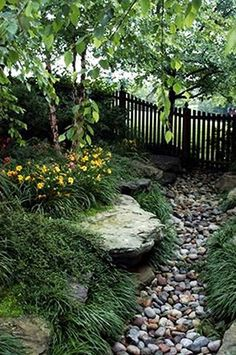Although this is a dry creek bed just for looks.I like the concept of landscaping a necessary drainage swale, to look like a creek bed. Landscaping With Rocks, Backyard Landscaping, Landscaping Ideas, Landscaping Software, Dry Riverbed Landscaping, Backyard Drainage, Drainage Ditch, Landscaping Borders, Natural Landscaping