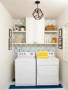 Organized and interesting laundry room! Wallpaper, striped floors, ceiling pendant