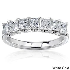 This stunning one-carat princess cut diamond ring is the accessory that goes with everything in your closet. This 14k-white gold band with seven diamonds looks lovely on its own or when paired with a solitaire or stacked with other bands.