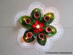 Easy and beautiful rangoli using almond leaves Flower Rangoli Images, Simple Rangoli Designs Images, Rangoli Designs Flower, Colorful Rangoli Designs, Rangoli Ideas, Rangoli Designs Diwali, Diwali Rangoli, Beautiful Rangoli Designs, Flower Designs