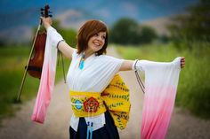 """lindsey stirling -- I love to see her in vibrant colors (and white) like this, but she looks great in pastels, too (like in the """"Shattered"""" video). Lindsey Stirling, Best Violinist, Piano Man, Piano Guys, Buckingham Nicks, Love To Meet, Character Modeling, Fleetwood Mac, Stevie Nicks"""