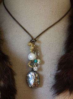 Tahitian wrapped in angel wing, leather, large pearl, sterling, dangle pearl, cz in sterling w turquoise…set w crushed pearl…so unique