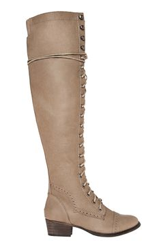Over the knee boots featuring a lace-up front, spectator detailing, low heel, and an inside zipper for easy on-and-off.