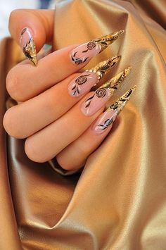 this nail art reminds me of evil queens like malifecent. maybe if you just change the colors pink and gold to black and violet/green, it will be an evil queen inspired nail art! :)