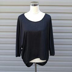 Black Hi-Lo Top Black 3/4 Sleeve Hi-Lo Top   This is NWOT Retail. Price Firm Unless Bundled. Tops