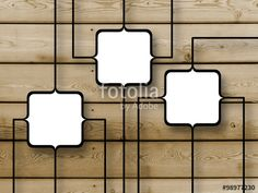 Close-up of three connected square frames on wooden boards background
