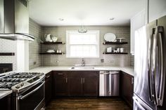 Check out those floating shelves! Makes the space appear larger and more open! Kitchen Shelves, Kitchen Cabinets, Cambria Quartz, Kitchen Design Open, White Countertops, Dark Cabinets, Barn Lighting, Stainless Steel Appliances, Rental Property