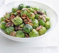 Creamed Sprouts ~ Go on, add a touch of crème fraîche and some juicy bacon to your sprouts and give them a wicked edge! ~ This sounds yummylicious! Subst ham for turkey bacon/?, & 1 cup slivered almonds for chestnuts (which are rare & expensive here) ? Kale Sprouts, Sprouts With Bacon, Brussels Sprouts, Creme Fraiche, Vegetable Side Dishes, Vegetable Recipes, Bacon And Butter, Roasted Chestnuts, Bbc Good Food Recipes