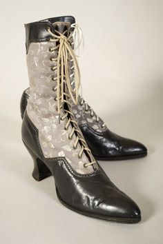 Black leather and grey twill boots. American, 1920,   Collection of the Kent State University Museum KSUM 1996.58.147ab