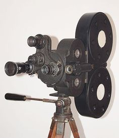 a Bell&Howell 35mm Eyemo 71Q cine camera with removable 400ft magazine (giving around 5 minutes of filming) and three lenses. This model was used by almost all allied military film units during WWII and certainly by the AFPU. It was reckoned to be the last word in portability!