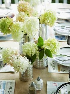 craft paper tablecloth, newspaper placemats and tin can vases for hydrangea