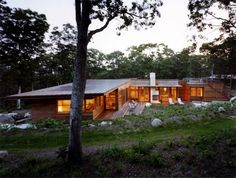 Single Story Dream Home In A Sloping Forested Landscape