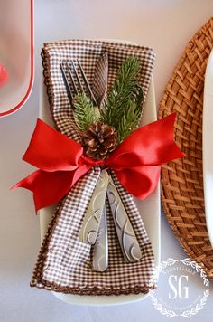WOODLAND CHRISTMAS TABLESCAPE-flatware with ribbon and floral pick. stonegableblog.com