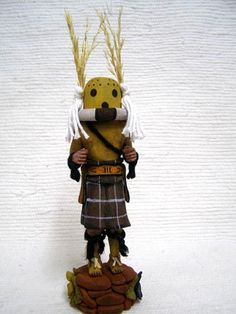 Native American Hopi Carved Cricket Racer Katsina Doll: Cricket (Soso'pa) is a Racer Katsina. This Katsina whips his opponents gently with a yucca whip when he is victorious. This is a very sweet full figure by Kevin Honyouti who is just starting to carve this style.