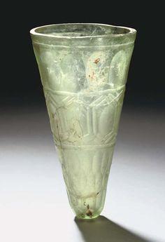 A SASSANIAN WHEEL CUT GLASS BEAKER IRAN, CIRCA 6TH CENTURY