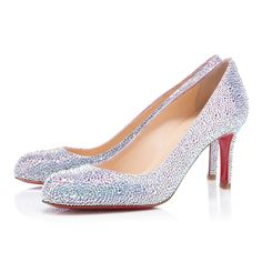 """Our beloved """"Simple Pump"""" has gotten a dazzling upgrade in our """"Simply Mary,"""" proving that there is truly nothing simple about her at all. Cloaked in hand-placed """"Aurora Boreale"""" Swarovski crystals, this timeless silhouette is transformed into a glistening show stopper."""