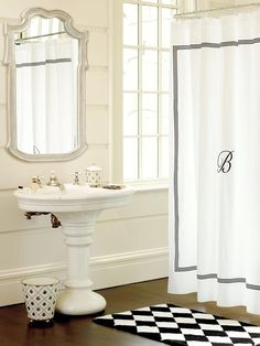 a monogrammed shower curtain by ballard designs adds a personal touch to this bathroom featuring a
