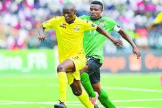 Ocean-Mushure-of-Zimbabwe-challenged-by-Christopher-Katongo-of-Zambia-during-the-2016-CHAN-football-match-between-Zimbabwe-and-Zambia-at-the-Rubavu-Stadium-in-Rubavu-Rwanda-on-Tuesday.jpg (1575×1050)