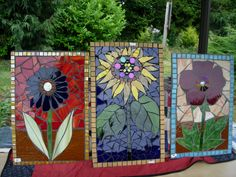 Various glass mosaic garden signs in bright and cheerful colors