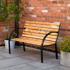 A traditional wooden slat bench with a metal frame. Available at Garden Mall Metal Garden Benches, Outdoor Garden Furniture, Bench Furniture, Garden Seating, Garden Chairs, Outdoor Chairs, Sun Lounger Chair, Sun Lounger Cushions, Patio Swing