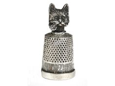 Kovový náprstek Kočičí hlava - Sběratelské NÁPRSTKY