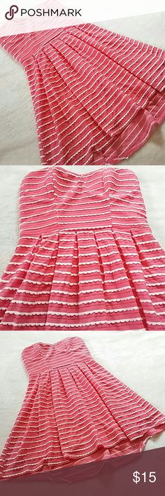 "🆕Listing! Paper Doll Scallop Strapless Dress This dress is so girly and flirty! Gorgeous coral color with an all over white scallop design. Strapless. Slight sweetheart neckline and pleating on the front. The bottom is slightly high-low. Gel stripe across top to ensure perfect fit. Elasticized around back. Poly/cotton blend. Somewhat stretchy. Lined. About 13.5"" pit to pit. About 28"" long. In EUC. Paper Doll Dresses Strapless"